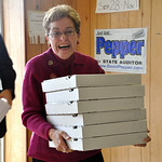 U.S. Rep. Marcy Kaptur arrives at the Lorain County Democratic Party phone bank this afternoon with a stack of Sambino's pizzas to thank party volunteers for their hard work. (CT photo by Ro …