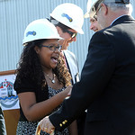 Tatum Hall, a fifth grader at Admiral King Elementary, shakes hands with Bill Sturgill, vice president of Lorain School Board, for participating in the groundbreaking for the new Lorain High …