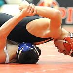 Elyria Ben Darmstadt pins Lorain Brandon Bartlome in 120 wt. class quarterfinals Jan. 23.   Steve Manheim