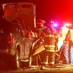 30NOV11 Rescuers work to free a woman trapped in her Chevy Impala after it collided head on with a Ford SUV on Abbe Rd near the Ford Plant.   photo by Chuck Humel
