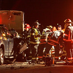 30NOV11 Rescuers  free a woman trapped in her Chevy Impala after it collided head on with a Ford SUV on Abbe Rd near the Ford Plant.   photo by Chuck Humel
