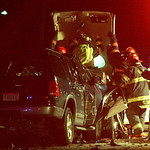 30NOV11 Rescuers finally peel back the roof on a white Chevy Impala that collided head on with a Ford SUV to free a woman who was trapped inside.  photo by Chuck Humel