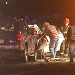30NOV11 Rescuers worked nearly an hour to free a woman trapped in her Chevy Impala after it collided head on with a Ford SUV on Abbe Rd near the Ford Plant.   photo by Chuck Humel