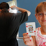 Magician Brad Schreiber teaches a class in magic in Avon.  Here Kaaitlyn Porter of Avon assists Brad Schreiber in teaching a card trick.  Photo by Tom Mahl