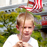 05/31/2010 Little boy with flag Hunter Wilson being carried in the Elyria Parade by his father Tom Wilson.  Photo by Tom Mahl