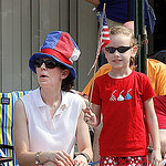 Mom Jennifer Lang (in hat) and daughter Morgan Lang age 7 were thoroughly enjoyin the elyria Parade. Elyria Parade.  Photo by Tom Mahl