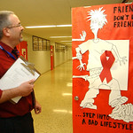 John Kuhn, Midview Schools Supt., looks over a decorated door for a contest at Midview High School Oct. 28.  Steve Manheim/CT