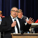 Midview Schools supt. John Kuhn speaks at a school board meeting to discuss massive budget cuts if a levy fails, at Midview High School on Dec. 19.   In rear, school board members Jim Barnha …