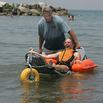 29JUN12   Samantha Taylor checks out the special beach equipment –the Mobi Chair–a type of amphibious beach wheelchair–that's available at Lakeview Park.         Photo  by Chuck Humel