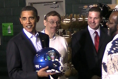 "22JAN10  Chronicle/Brad Dicken President Barack Obama receives a custom helmet from workers at Riddell in Elyria. The presidential seal and the number ""44"" were emblazoned on the helmer. Obama is the 44th president of the United States."