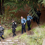 Seattle police search under the I-5 freeway for the suspect in the killing of four Lakewood, Wash. police officers, Monday, Nov. 30, 2009 in Seattle. (AP Photo/Kevin P. Casey)