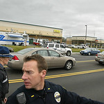 Puyallup Police Lt.  Dave McDonald, and Washington State Trooper Brandy Kessler, left, lead a pool of print and broadcast journalist, Monday, Nov. 30, 2009, in Parkland, Wash., to view the s …