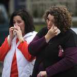 Michelle Schott and Mandy Standfield of Tacoma, Wash. dropped by to pay respects at the memorial site at the Lakewood Police Department on Monday, Nov. 30, 2009. Police intensified the hunt  …