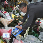 A Bremerton, Wash. police officer leaves a police patch at the Lakewood, Wash., Police Department on Monday, Nov. 30, 2009. Police intensified the hunt Monday for the man wanted in the coffe …