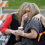 Two women, who declined to give their names, comfort each other, Monday, Nov. 30, 2009, as they visit a memorial at the Lakewood Police headquarters in Lakewood, Wash. Four Lakewood Police o …