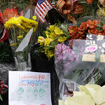Flowers and a hand-written message from a child are shown Monday, Nov. 30, 2009, at a memorial at the Lakewood Police headquarters in Lakewood, Wash. Four Lakewood Police officers were fatal …
