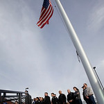 Lakewood police officers and other employees stand next to a flag flying at half-staff during a press conference Monday, Nov. 30, 2009, in Lakewood, Wash. Four Lakewood Police officers were  …