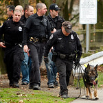 Seattle SWAT search for the suspect in the killing of four police officers in Parkland, Wash., on Monday, Nov. 30, 2009 in Seattle. A heavily armed SWAT team stormed a Seattle home Monday wh …
