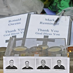 A photo of the four slain Lakewood police officers is seen at the memorial site at the Lakewood Police Department on Monday, Nov. 30, 2009.  (AP Photo/The News Tribune, Lui Kit Wong)