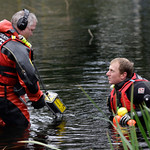 Shaun Darby, right, and Curtis Filleau, both members of the Pierce Co. Sheriff's dive team, search a pond at the Willows Apartments, Monday, Nov. 30, 2009, in Parkland, Wash. near the scene  …