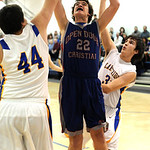Open Door Jordan Wright goes to hoop by Lake Ridge Jimi Seidel, left, and Devin Gabriel Jan. 17.  Steve Manheim