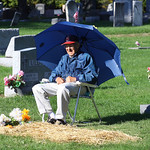 22oct10 bishop— William Petroff, 91, sits at the grave of his wife Jeanne in Fields Cemetery in North Ridgeville