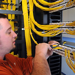 Jason Bailey of Zenith Systems completes work patch panels for student use in the computer and maintenance room at Ridge Campus of LCCC on Jan. 18.  Students in engineering technology will u …