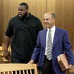 Cleveland Browns defensive lineman Shaun Rogers, left,  appears in Cuyahoga County Common Pleas Court with his attorney Pat D'Angelo during his arraignment on a charge of carrying a conceale …