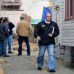 Cleveland Police Deputy Chief Ed Tomba walks from the back of the home of Anthony Sowell in Cleveland Thursday, Nov. 5, 2009. Police are planning on a further search of the house where the r …