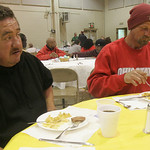 St Mary's held an Easter Dinner after Masses at the Newton Commons on St. Mary Way. Isadro Casarez, left and Albert Temple, both of Elyria who find occasional work through Minute Men, sat do …