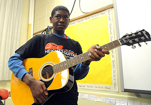 Student receives guitar