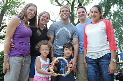 Taylor Chapple, center, visits with his family in Lorain Aug. 14.  front, left, sister Meghan Chapple-Brown,  girlfriend Jamie Cornelius,  brother Kyle Chapple with his wife Autumn.  front left, Zadie Brown, niece, and Max Chapple, nephew.    Steve Manheim