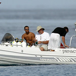 "FILE – In this Oct. 5, 2004, file photo, Tiger Woods, left, drives a boat off  the yacht ""Privacy,"" anchored off the luxury resort Sandy Lane, in Barbados.  It's amazing that Woods has manag …"