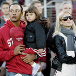 FILE – Tiger Woods with his daughter Sam and wife Elin are seen before the start of a NCAA college football game between Stanford and California in Stanford, Calif., in this Nov. 21, 2009 fi …