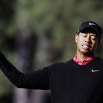FILE – This is an April 8, 2007, file photo showing Tiger Woods reacting to a missed birdie putt on the 14th green during the final round of the 2007 Masters golf tournament at the Augusta N …