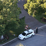 A security officer guards the area in front of Tiger Woods' house in Windermere, Fla., Friday, Nov. 27, 2009. Woods was injured in an accident early Friday when his sport utility vehicle str …