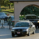 Two vehicles with the Florida Highway Patrol exit the front gate of Isleworth where Tiger Woods lives in Windermere, Fla., Sunday, Nov. 29, 2009 (AP Photo/John Raoux)