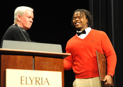 Tracy Sprinkle with Elyria coach Kevin Fell at the 2012 Golden Helmet Award on Nov. 15.  Steve Manheim