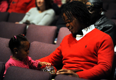 Tracy Sprinkle shows his niece and goddaughter Kayden Sprinkle the Golden Helmet Award on Nov. 15.  Steve Manheim