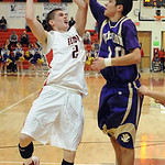 Elyria Kody Bender is fouled  by Vermilion Anthony Rini  in first half Jan. 29.  Steve Manheim