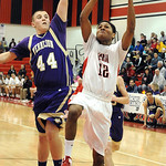 Elyria Anthony Duckett scores while being fouled by Vermilion John Austin for a three-point play in first half Jan. 29.  Steve Manheim