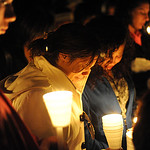 "Marissa Papon, left, and Alyssa Lawrence, friends of Alexandra ""Allie"" Clifford, attend at candlelight vigil for Allie at East Rec. Park on Feb. 28.  Steve Manheim"