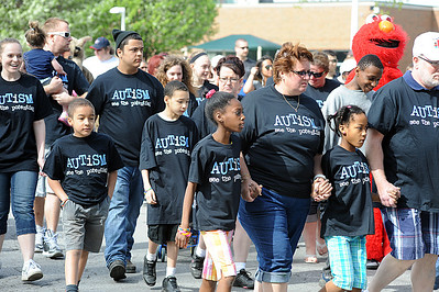 """Participants take off in the third annual """"Walking With Autism,"""" a one-mile autism walk to help pay for therapeutic playground equipment for the Spectrum Resource Center and School in Lorain at LCCC on May 4.  There were 500 walkers in the fundraiser.  Construction will  start in July.   Steve Manheim"""