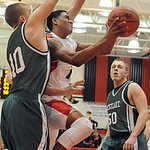 Elyria Isaiah Walton puts up shot over Westlake Bryan Mackenzie Jan.8.   Westlake 50 is Jamie Lackner.     Steve Manheim