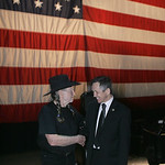 29JAN12  Country singer Willie Nelson arrived in Lorain to play a fundraiser concert for Dennis Kucinich. Dennis and Willie talk and shake hands on stage before the concert.    photo by Chuc …