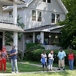 East Cleveland residents watch the scene  Sunday, July 21, 2013, close to where three bodies were recently found in East Cleveland, Ohio. The bodies, believed to be female, were found about  …