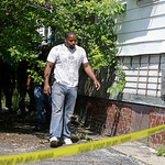 An East Cleveland police officer searches a house Sunday, July 21, 2013 where one of three bodies were recently found in East Cleveland, Ohio. The bodies, believed to be female, were found a …