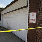 A garage is shown Sunday, July 21, 2013, where a body was found recently in East Cleveland, Ohio.  The bodies, believed to be female, were found about 100 to 200 yards (90 to 180 meters) apa …