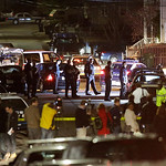 Police work a crime scene Friday, April 19, 2013, in Watertown, Mass. A tense night of police activity that left a university officer dead on campus just days after the Boston Marathon bombi …
