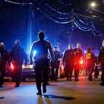 Police officers walk near a crime scene Friday, April 19, 2013, in Watertown, Mass. A tense night of police activity that left a university officer dead on campus just days after the Boston  …